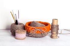 Crochet orange linen basket. Linen yarn and crochet orange linen basket Royalty Free Stock Images