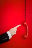 crochet outre du rouge de téléphone Photos libres de droits