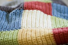 Crochet Patchwork Blanket. Close up of a crochet patchwork blanket stock photo