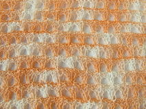 Crochet pattern background in coral Royalty Free Stock Photos
