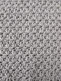 Crochet pattern background in grey Stock Photo