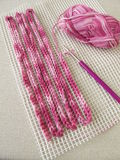 Crochet pattern on woven material Stock Photo