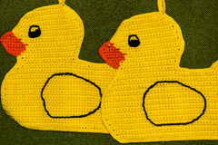 Crochet potholder, yellow ducks Royalty Free Stock Photography