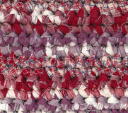 Crochet rag rug in red, white and purple shades Stock Photos