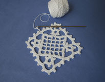Crochet sample for tablecloth or napkin. Crochet sample for tablecloth or napkin from cotton on blue background Stock Image