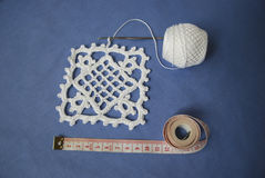 Crochet sample for tablecloth or napkin with meter. Crochet sample for tablecloth or napkin from cotton with meter on blue background Stock Photos