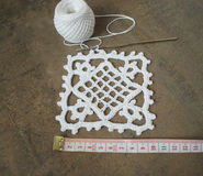 Crochet sample for tablecloth or napkin with meter. Stock Photos
