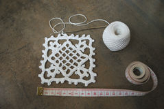 Crochet sample for tablecloth or napkin with meter. Crochet sample for tablecloth or napkin from cotton on brown wooden background Stock Image