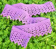 Crochet scarf on clover leaves Stock Images