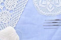 Crochet set. Crochet thread, doily and hooks. Stock Photo