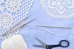 Crochet set. Crochet thread, doily, scissors and hooks. Stock Photography