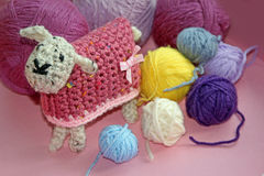 Crochet sheep and wool. Photo of a cute woolly crocheted sheep with colourful balls of wool. photo taken 12th oct 2016. photo ideal for hobbies,crafts etc royalty free stock image