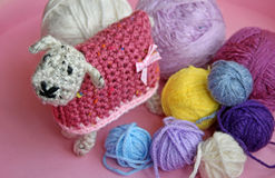 Crochet sheep and wool. Photo of a cute woolly crocheted sheep with colourful balls of wool. photo taken 12th oct 2016. photo ideal for hobbies,crafts etc royalty free stock photos