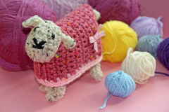 Crochet sheep and wool. Photo of a cute woolly crocheted sheep with colourful balls of wool. photo taken 12th oct 2016. photo ideal for hobbies,crafts etc stock photo