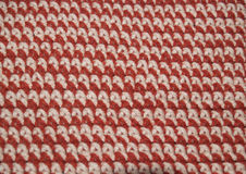 Crochet single stitch rows. Single stitch crochet in alternating rows of tan and rust yarn to demonstrate stitch consistency Stock Photography