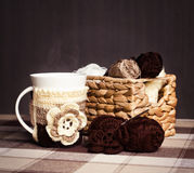 Crochet, skeins of yarn and cup of coffee. On a dark background Royalty Free Stock Image