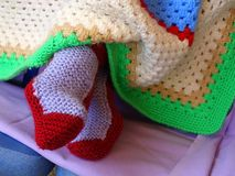 Crochet Socks and Blanket. Colorful wool crocheted socks and blanket, hand made royalty free stock photo