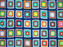 Crochet squares bright wool blanket Stock Photos