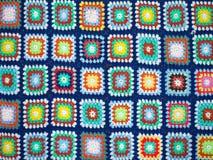 Crochet squares bright wool blanket Stock Photos