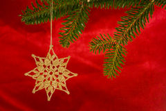 Crochet star. Golden star on christmas tree Royalty Free Stock Images