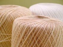 Crochet Thread. Three Balls of Ecru and White Crochet Thread Royalty Free Stock Images