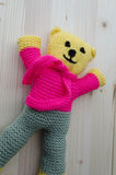 Crochet toy. Teddy bear with pink and blue grey color Royalty Free Stock Photo