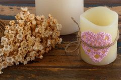 Crochet valentine heart on candle with flowers Royalty Free Stock Images
