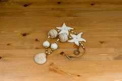 Crochet white-beige beads handmade pendant natural seashel Stock Images