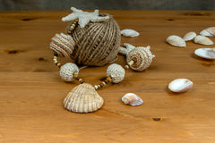 Crochet white-beige beads, seashells and skein of twin royalty free stock image