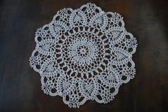 Crochet white ring napkin from cotton. Stock Photos