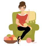 Crochet woman. Woman sat in armchair with yarn and crochet hook Stock Photos