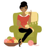 Crochet woman. Woman sat in armchair with yarn and crochet hook Stock Image