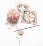 Crochet work and balls of yarn stock images