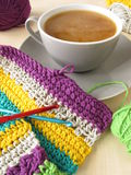 Crochet work and a cup of coffee with milk Royalty Free Stock Photography