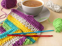 Crochet work and a cup of coffee with milk Stock Photo