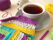 Crochet work and a cup of coffee Royalty Free Stock Photography