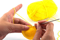 Crochet work. Women's hands doing crochet work Stock Photos
