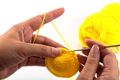 Crochet work. Women's hands doing crochet work royalty free stock photography