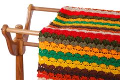 Crocheted Afghan Cover On Rack stock photography