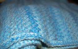 Crocheted baby afghan blue yarn. Detail of crochet stitches using textured stitch in shades of blue Royalty Free Stock Photos