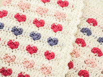 Crocheted Baby Blanket: Pink and Purple Hearts on White. Crocheted baby blanket: white with pink and lavender hearts Stock Image