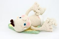 Crocheted Baby Doll On Back With Feet Up Stock Images