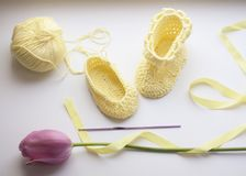 Crocheted baby shoes in progress royalty free stock images
