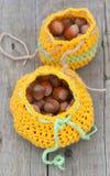 Crocheted bag with hazelnut Royalty Free Stock Image