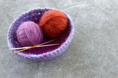 Crocheted Basket with Yarn. And crochet hooks Royalty Free Stock Image