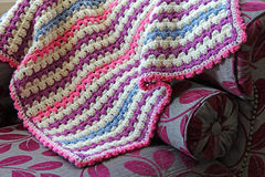 Crocheted blanket on chaise Stock Photography