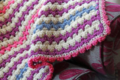 Crocheted blanket on chaise Royalty Free Stock Photography