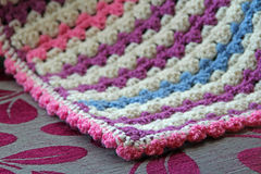 Crocheted blanket on chaise Royalty Free Stock Image