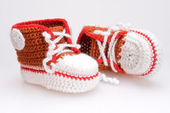 Crocheted booties for a boy Royalty Free Stock Image