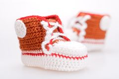 Crocheted booties for a boy Stock Images